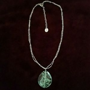 Double chained, silver necklace with green gem